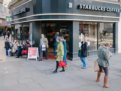 Market Street and Tib Street, Manchester (Peter.Bartlett) Tags: chair bag window unitedkingdom corner urbanarte door peterbartlett girl candid uk m43 kodakportra160emulation cafe shopfront olympusomdem5 shopping people streetphotography doorway boy cellphone lunaphoto standing man urban walking vsco coffeecup poster microfourthirds mobilephone shopwindow manchester sign city colour men