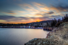 Clouds in Motion (Paul Domsten) Tags: lakesuperior minnesota northshore longexposure neutraldensityfilter pentax water lake ice sunset trees rocks sigma clouds tettegouchestatepark sky landscape