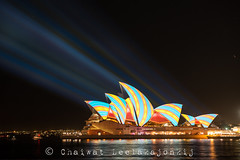 Vivid sydney 2013 (Chaiwat lee) Tags: new light red orange brown white house color colour building green art tourism water yellow festival wales architecture night spectacular lights evening design harbor opera long exposure pattern purple bright theatre harbour south famous sydney creative australian sails cyan vivid australia landmark icon structure quay illuminated celebration projection editorial circular