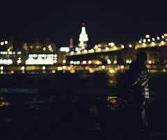 Embrace. (Instant Vantage) Tags: street nyc newyorkcity woman newyork man building love skyline brooklyn canon eos lights hugging couple state bokeh manhattan candid dumbo 85mm lovers empire brooklynbridge 5d embrace 85 brooklynbridgepark 85l canonef85mmf12liiusm canoneos5dmarkiii 5dmarkiii