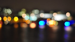 Bokeh Along The Thames (mendhak) Tags: wallpaper reflection london water thames night river focus glow bokeh southbank hungerford oof mendhakwallpaper
