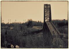 Bridge over salmon waters. (StarRider1300) Tags: bridge bw sepia traffic newbrunswick toned mirimichi