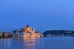 Hungarian Parliament Building at night. Budapest. Hungria (tichik_stitch) Tags: old city travel blue light sky urban panorama house reflection building tourism water beautiful architecture night river landscape evening town twilight europe hungary cityscape view place riverside state dusk famous capital budapest sightseeing style parliament landmark scene tourist symmetry national government flowing sight neogothic duna danube embankment banks hungria hungarian hangrian
