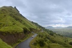 Satara (Pratik Bhakkad) Tags: road travel blue india mountains green car rain clouds canon landscape colours monsoon maharashtra satara canon550d
