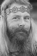 What has He been up to? (wyojones) Tags: blackandwhite bw usa white black smile look festival hair beard eyes texas expression trf warrior faire crown grayscale fest renaissance renfest headband greyscale barbarian texasrenaissancefestival toddmission mostouche wyojones