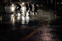thunderstorm (jonron239) Tags: girls man london rain bicycle silhouette umbrella boots camden taxi running headlights