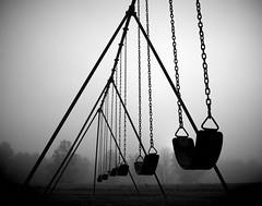Empty Swings (re-edit) (tim.perdue) Tags: empty swings black white bw monochrome dream dreamlike dreamy fog foggy mist metro park big meadows playground highbanks edit vignette grain dark most interesting interestingness swing swingset childhood lost columbus ohio composition shadow silhouette minimalism