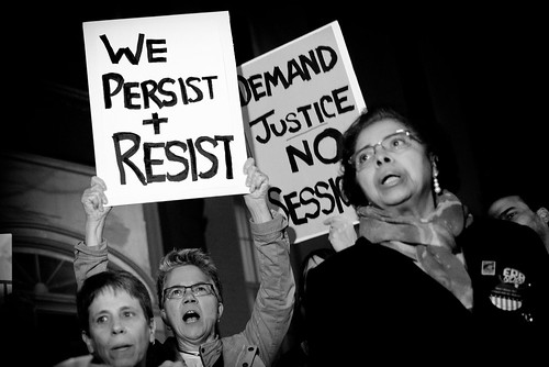 From flickr.com: We Persist And Resist, a protest outside Mitch McConnell