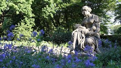 Statue in the Scent Garden - Volkspark Friedrichshain (luciwest) Tags: berlin friedrichshain prenzlauerberg volksparkfriedrichshain park nature inaberlinminute videostill statue flowers blumen purple lila woman child frau kind duftgarten scent garden bloom bluete