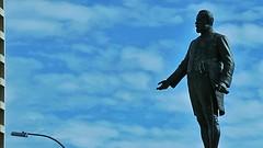 Wingardium Leviosa (Theen ...) Tags: city blue sky statue bronze square beard hand zoom streetlamp coat south australian australia charles victoria kingston cameron sword adelaide frock scroll rapier sculptor sculpted statesman levitating 1916 hiltonhotel unveiled wizardry eminent theen alfreddrury leviosa wingardium flickrandroidapp:filter=none