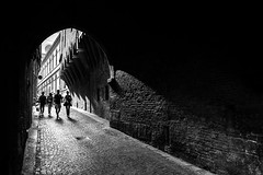 Entering the gate (hzeta) Tags: street light people white black texture blanco luz stone backlight contrast contraluz walking calle puerta gate y gente negro medieval contraste texturas caminando piedra arcada mygearandme mygearandmepremium