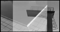 Sommerbad Neukölln [analog] (__J) Tags: blackandwhite bw berlin film water analog swimming canon 50mm wasser schwimmen kodak iso400 scan scanned sw a1 analogue canona1 kodakbw400cn neukölln tempelhof divingboard publicpool springboard columbiadamm canonfd50mm18 schwimmbad divingplatform freibad canonfd sprungbrett sprungturm schwarzweis openairpool sommerbadneukölln columbiabad 10meterbrett