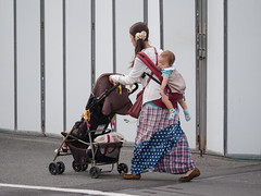 Mama is strong  [explored] (kasa51) Tags: street city people baby japan lumix mother olympus panasonic yokohama f28 omd totsuka em5 35100mm