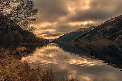 Lock Eck Dark and Light (Bathsheba 1) Tags: uk trees light sunset sky storm mountains reflection nature water grass clouds reflections landscape geotagged evening scotland highlands scenery day colours v