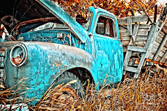 Baby Blue Truck (Scott Prokop Photography) Tags: auto old travel blue light brown canada green fall classic abandoned field grass wheel yellow metal rural truck vintage wooden junk rust automobile antique farm parts wheat country neglected engine pickup tire cargo storage photoblog fender pasture transportation worn vehicle hood weathered headlight harris saskatchewan retired deserted rugged oldfashioned flatbed