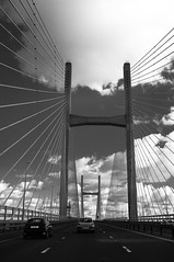 Travelling to a new place (Mark Grant-Jones) Tags: road bridge england cloud cars car wales clouds river vanishingpoint fuji border perspective severn fujifilm rivercrossing x100