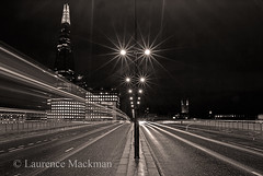LondonBridge 033 E W BWS (laurencemackman) Tags: lighting longexposure bridge england london tower cars glass architecture modern night reflections londonbridge concrete photography lights twilight traffic piers architect historical elevation architects shard riverthames renzopiano span streamline londonbridgestation londonskyline broadwaymalyan theshard motthayandanderson lordholford