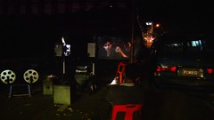 Old fashioned filmprojectors on Hungry Ghost Festival, this is a screenshot from the camcorder  -sorry! :P (ShambLady) Tags: old light red yellow festival jaune movie asian rouge temple projector ghost hell chinese fil lan malay