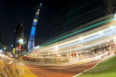 FOOT OF THE TOKYO SKYTREE (ajpscs) Tags: longexposure nightphotography lightpainting japan japanese lights tokyo nikon nightshot streetlights illumination  nippon  lighttrails asakusa afterdark hikari  trailoflights fisheyelens  d300 105mm traillights riveroflights oshiage  traffictrail   skytree ajpscs streaminglights narihirabashi toburailway tokyonightview  tokyoskytree tbuisesakiline tkysukaitsuri  flowinglights trainlighttrail tokyoskytreestation  tokyo japan tokyoyakei