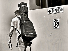 On the Road (sea turtle) Tags: seattle street blackandwhite bw guy tattoo blackwhite alley downtown market guitar candid strangers pikeplacemarket pikesplacemarket pikesplace pikeplace