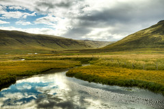 Flowing into Hnafli (IceNineJon) Tags: sky nature water clouds river flow photography iceland europe places hdr westfjords hnafli canon7d inspiredbyiceland vision:mountain=0806 vision:sunset=0614 vision:sky=0959 vision:outdoor=0875 vision:clouds=0942 vision:car=0642