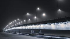 Evening mist II (Keijo Savolainen) Tags: road bridge winter shadow mist snow seascape cold reflection ice fog night finland landscape dawn cool helsinki frost streetlights shoreline winterscape