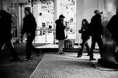 comic.book.guy (jonathancastellino) Tags: street leica toronto film analog 35mm mall store downtown comic strangers stranger sneakers figure analogue yonge dundas eatoncentre figures seller pusher comicbookguy