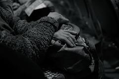 Secured (MPnormaleye) Tags: urban blackandwhite bw detail monochrome 35mm blackwhite sweater hands hand atmosphere utata weathered unposed ambience greyscale bwmonochrome