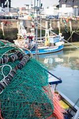 Fishing nets (James Waghorn) Tags: sea net water reflections prime boat kent spring fishing nikon bokeh harbour whitstable fishingnet 35mmf18 d7100