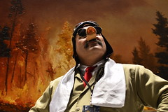 AZ282 Porco (skippyclese) Tags: trees hat forest scarf painting nose fire pig flyer cosplay tie shades burning cap oil backdrop forestfire mustache con heroic animazement porco flyboy animazement2014