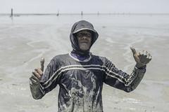 Fisherman (PandaOppa) Tags: red people human farm sekinchan malaysia river ocean fujifilm moment sky selangor