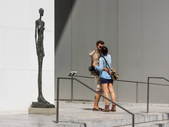 'Le voyeur ... ' (Canadapt) Tags: nyc shadow sculpture woman man lines statue kiss angles moma giacometti canadapt