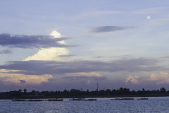 Huddling together for the night (Keith Kelly) Tags: city cruise sunset sky moon water evening boat asia cambodia seasia southeastasia capital phnompenh kh aroundtown mekong tonlesap boatride mekongriver kampuchea