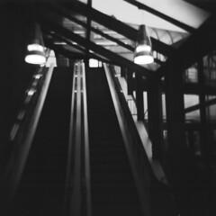 Escalator (rotabaga) Tags: longexposure 120 6x6 mediumformat nordstan gteborg lomo lomography sweden gothenburg escalator toycamera plastic diana sverige vignetting neopan100 rulltrappa mellanformat