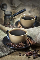 Two cups of coffee with spices (Speleolog) Tags: wood food brown black hot cup coffee breakfast dark studio star cafe beige junk raw break cinnamon spice rustic beverage seed bean gourmet mocha drinks heat mug backgrounds stick espresso caffeine liquid heap saucer textured roasted nonalcoholic scented anise ingredient jute