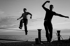 Beach wire walking (DonStevie) Tags: leica light sunset blackandwhite bw beach monochrome beautiful evening blackwhite acrobats brightonbeach wirewalking leicam240 leicamonochromlove