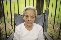Krung Thep, the city of angels (slow paths images) Tags: park travel portrait face lady pose asian thailand asia southeastasia sitting grandmother bangkok thai oldwoman granny wrinkled chatuchak krungthep thecityofangels peopleofbangkok fredcan pagesfredcanongephotography166659476684013