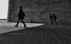 street city shadow people urban blackandwhite bw sun geometric public girl monochrome germany shadows geometry walk candid citylife olympus moment passage