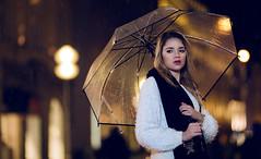 On a rainy night (One_Penny) Tags: bayern deutschland germany münchen bavaria canon face girl hair munich photography portrait woman canon6d umbrella rain night city town lights bokeh colors scarf urban street 135f2 gold