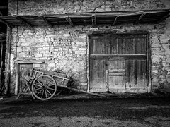 Lost in time (Lanceflot) Tags: bugey france lost time nostalgic old fashion blackwhite architecture building street village ain rhônealpes countryside door cart hay straw history