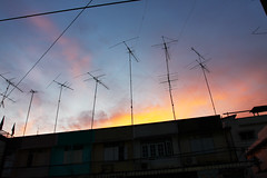 sunset antennas (Nuch_>cha) Tags: roof sunset red sky sun color television radio sunrise season dawn rainbow colorful dusk over sunny communication shade transportation mast feeling emotional antenna telecommunication