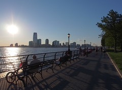 The Hudson Sun (beanhead4529) Tags: park nyc newyorkcity jerseycity manhattan financialdistrict batterypark hudsonriver batteryparkcity lowermanhattan olympus12mm