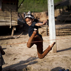 Let's jump - Laos (Steven Goethals) Tags: travel portrait people playing game kids eos jumping asia village child culture peoples explore human asie laos ethnic minority lao hmong nam visage indochine indochina ethnology khamu ethnique goethals khmu ouriver stevengoethals