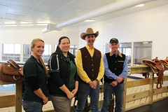 ERC staff members Kathryn, Erin, and Mike pose with Todd after a successful saddle fitting workshop.