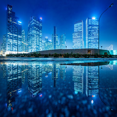 Urban Nights (Scintt) Tags: road city blue urban panorama reflection tourism architecture modern night marina buildings lights mirror evening bay coast hall highway singapore long exposure glow cityscape slow place district centre central structures symmetry east business hour shutter cbd expressway exploration financial stitched offices ecp raffles tracel scintillation scintt