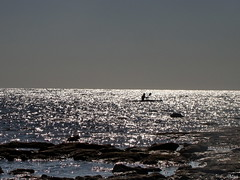 Silver Sea (Mari Rasti) Tags: sea sky sunlight man stone silver boat waves iran paddle gheshm silversea sonyh50 marirasti
