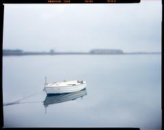 a boat (thodoris markou) Tags: analog film 4x5 largeformat color graflex speedgraphic kodak aero ektar 178mmf25 fuji cdu xpro crossprocess jobo cpe2 boat blue clouds