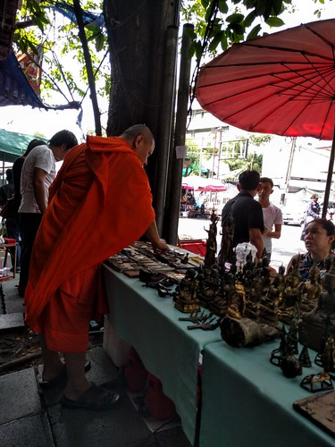 Monk shopping for Thai Buddhist amulets - Bangkok