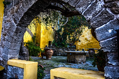 Rhodes Old Town yard (rodiann) Tags: rhodes rodi rhodos rodos greece grecia grece colours yellow yard well pitcher tree arch rocks outdoor