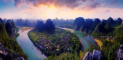 Guilin panoramic 01 (Xiyeimages) Tags: china travel cruise blue sunset cloud sun mountain holiday mountains color reflection tourism nature water beautiful field grass rain rock fog forest river landscape island evening boat high fishing fisherman scenery colorful asia paradise glow quiet purple dusk guilin yangshuo rustic wide perspective rocky peak scene panoramic calm fresh level rivers mysterious hoodoo geography lime geology oriental overlook overlooking karst height lijiang rolling township grotesque geological topography lijian swerve guiling yangsu
